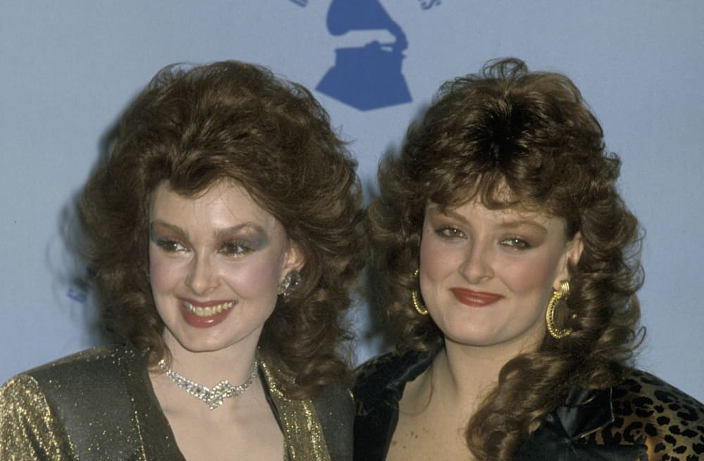 Country singer Naomi Judd, right, is joined by her daughters, singer  Wynonna, left, and actress Ashley, during the 1998. Academy Awards show in  Los Angeles.
