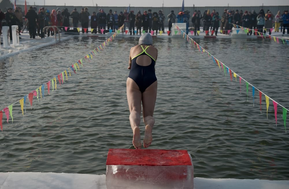 d459f0e0f Swimmers take icy plunge at China snow festival - AOL News