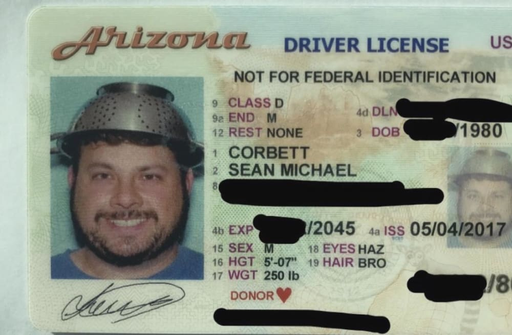pastafarian photographed in driver s license wearing spaghetti