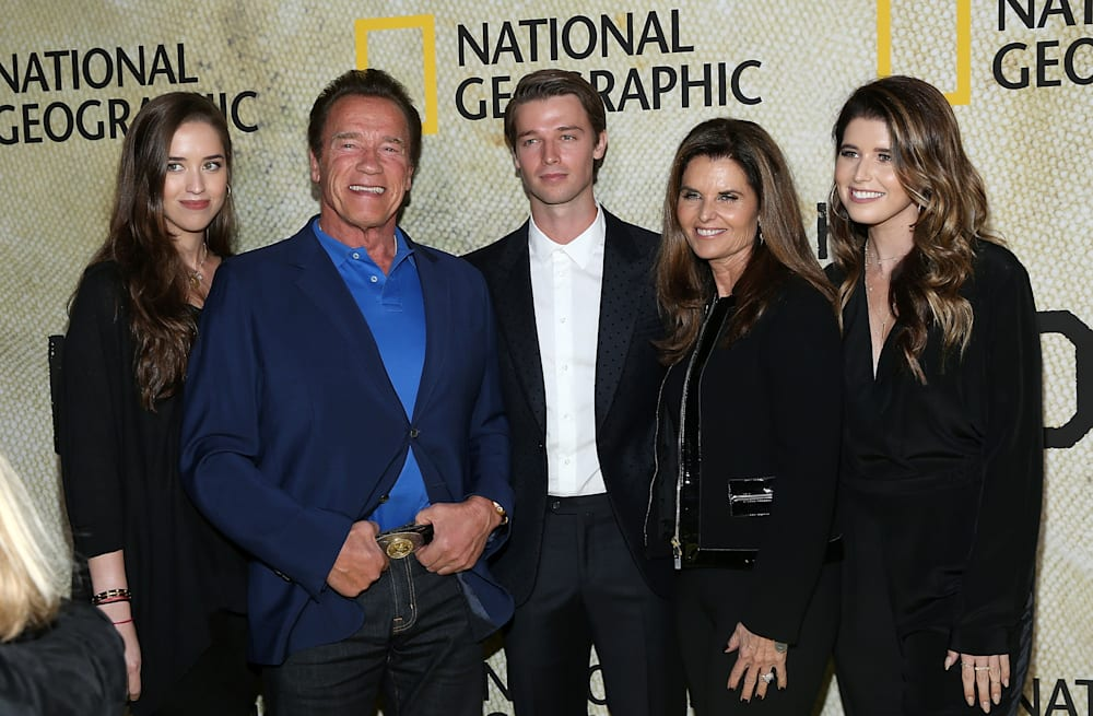 Arnold Schwarzenegger and ex Maria Shriver pose with three