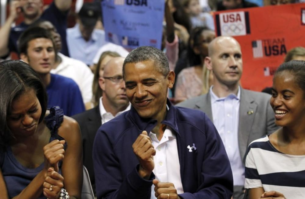 aed1742c3 Barack Obama wore a black bomber jacket with '44' stitched on the ...