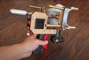 YouTuber's DIY gun shoots masks onto people's faces