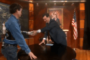 Dean Kamen shows off his prosthetic arm on The Colbert Report