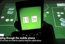 Poker Surface beautifully weds multitouch table, cellphone interaction and illicit gambling