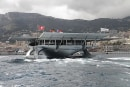 First solar-powered boat to circle the world pulls into home port, contemplates next move