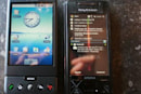 T-Mobile G1 and Sony Ericsson X1 seen side-by-side, molten lava hangs head in shame