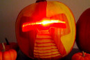It's the Great Robotic Overlords, Charlie Brown: make a Cylon jack-o-lantern