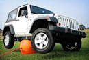 Titan's air jack lifts your car with hot air, can't be used for a game of volleyball
