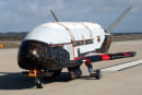 X-37B spaceplane back on earth after 7 months of spying on us, shooting aliens