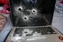 Border security guards kill -- literally kill -- a MacBook (update: video!)