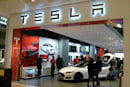 Musk stands behind Tesla Model S safety, modifies warranty to cover fire damage