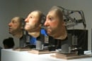 Creepy robotic heads serenade your wallet from deep inside the uncanny valley