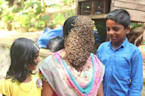 Indian woman covers face with hundreds of bees to create buzz for conservation