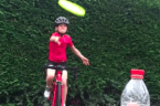 Young Cyclist Smashes the #BottleCapChallenge With a Frisbee