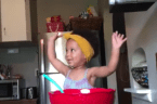 Jesus First, Baking Second: Little Girl Raises Arms in Worship Before She Bakes Banana Bread