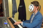 This guy plays Mario Kart while playing the piano