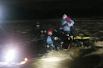 Family trapped in SUV gets rescued from gushing flood waters