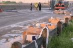 Truck crash covers highway in toilet paper
