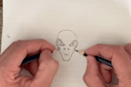 Watch this ambidextrous artist draw an incredible alien with both hands