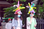 Tourist spot in China provides visitors with balloon hats to maintain social distancing