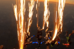 Stunning footage captures skydivers light up the sky with trail of sparks