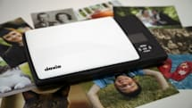 Doxie Flip is a battery-powered, flatbed-style portable scanner that costs $149