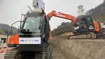 「5G」で無人の建機を動かす、KDDIと大林組らが遠隔操作デモ公開