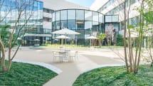 KDDIが研修施設「LINK FOREST」を4月1日にオープン、歴代の端末が揃ったミュージアムも併設