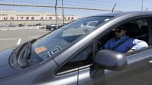 Uber opens car-leasing program to lure in more drivers