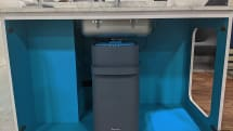 Smart garbage disposal composts your food scraps instead of grinding them up