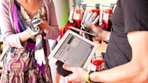 ERPLY's mobile credit card reader handles NFC payments on an iPad, obliterates the check-out line