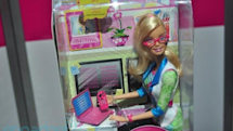 Barbie slides into the cubicle, becomes a computer software engineer
