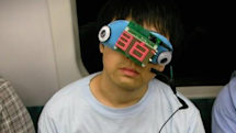 Noriko-san subway sleeping mask lets other passengers know to where to wake you, looks really cool