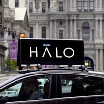 Lyft buys a startup that runs ads on top of ridesharing cars