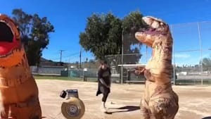 Guy in T-Rex costume gets hit in crotch