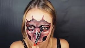 Make-up artist paints gory skull on her face