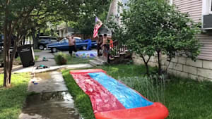 Dad hurts himself on slip and slide
