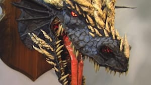 Artist builds dragons out of paper mache