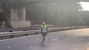 Paraplegic man completes marathon on crutches
