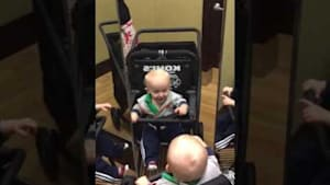 Baby sees three reflections in store mirror