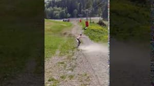 Guy skateboarding downhill tumbles and faces fall