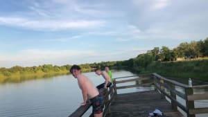Guy slips and rams his knees into dock railing