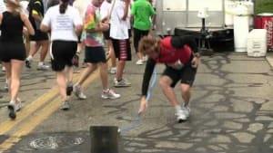 Distracted marathon runner collides into barrier