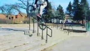 Man bails on bike attempting to do backwards jump