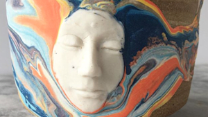 This artist always puts a 3D face in his pottery pieces