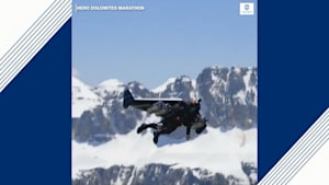 'Jetman' soars over Italian Alps in jet pack