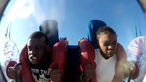 Girl's wig falls of during slingshot ride