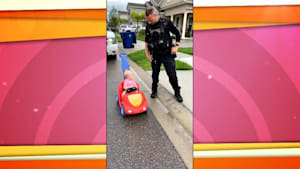 Police officer 'pulls over' baby daughter in her toy car