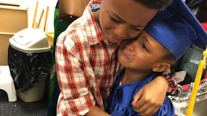 #GoodNewsRUHLES: Proud brother hugs sister after pre-k graduation