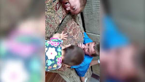 Big brothers try to teach baby sister how to nap